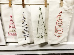 Give the stitcher in your life a kit to make these Christmas themed napkins from Starla Joy Embroidery inside Seasons to Follow.